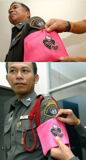 Thai police officers who break rules will be forced to wear hot pink armbands featuring