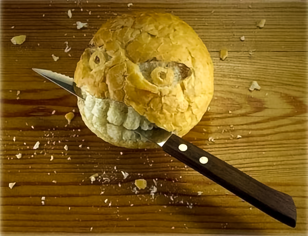 Bread with bread knife in mouth