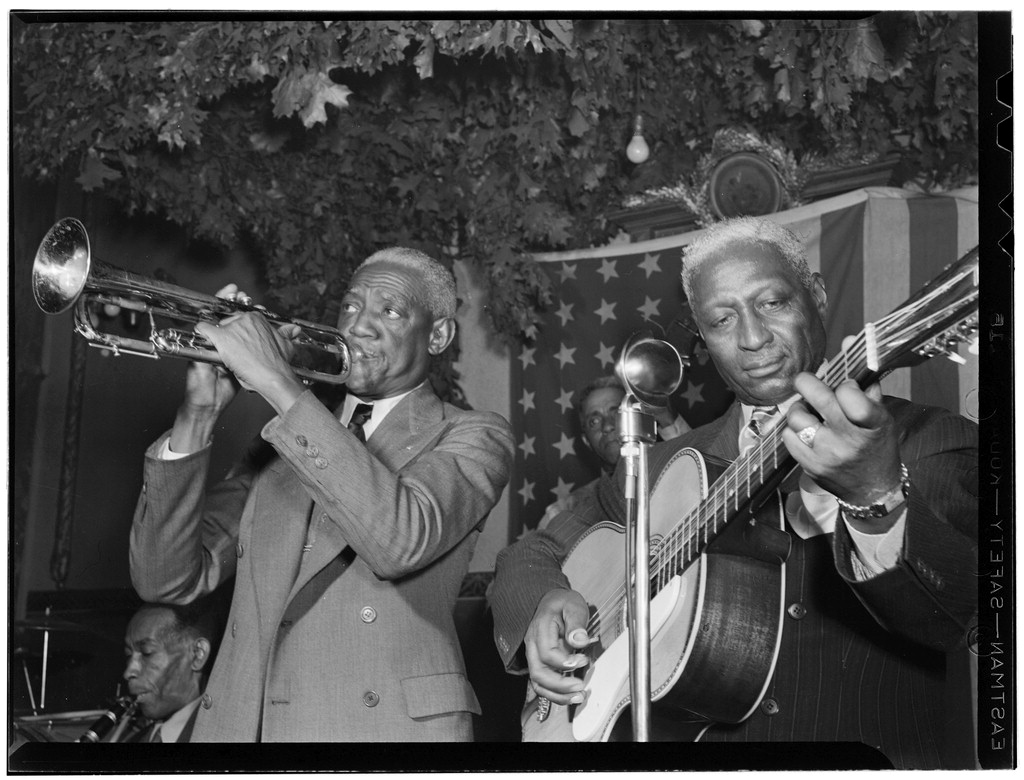 Portrait of Bunk Johnson, Leadbelly, George Lewis, and Alcide Pavageau, Stuyvesant Casino, New York, N.Y., ca. June 1946