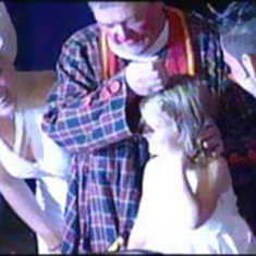 Two children baptised in big top