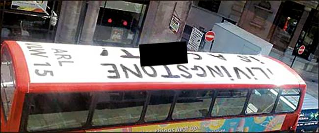 Double-decker bus driven around London with guerilla graffiti