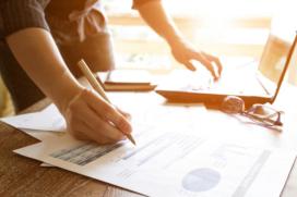 Budgeting, business people analyzing returns