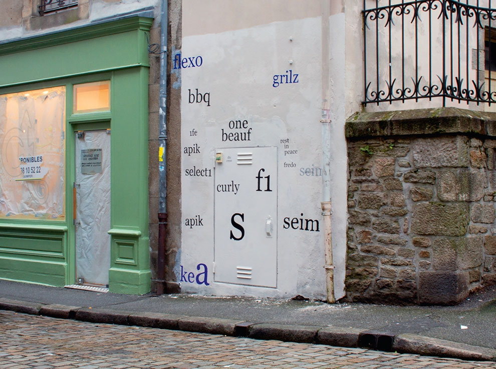 Artist paints over 'tag' graffiti with legible typefaces
