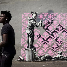 Banksy needles France with migrant mural blitz in Paris