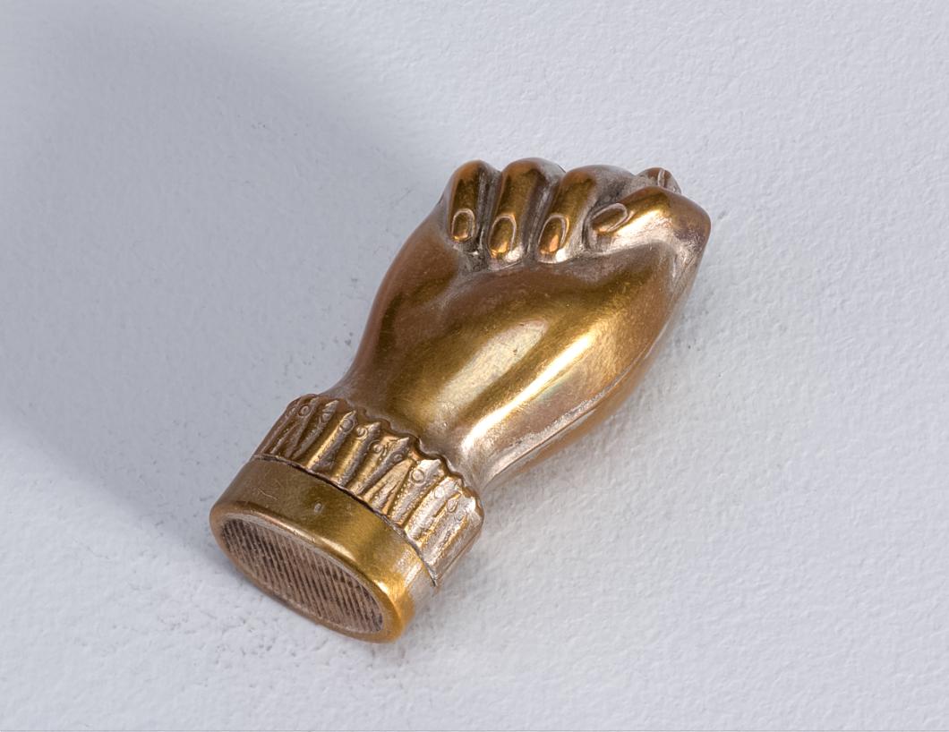A copper colored fist