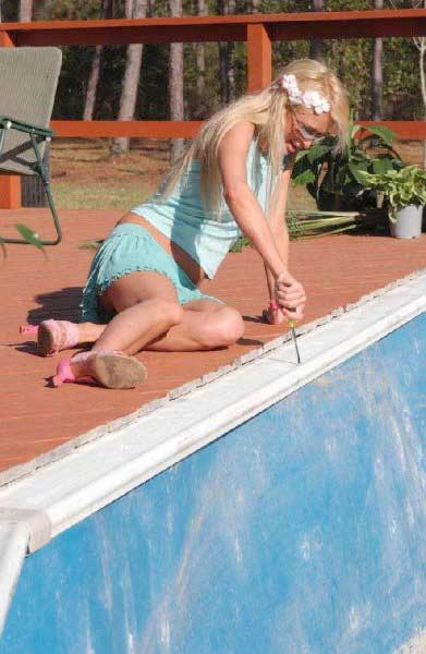 Paris Hilton photographed screwing by the pool